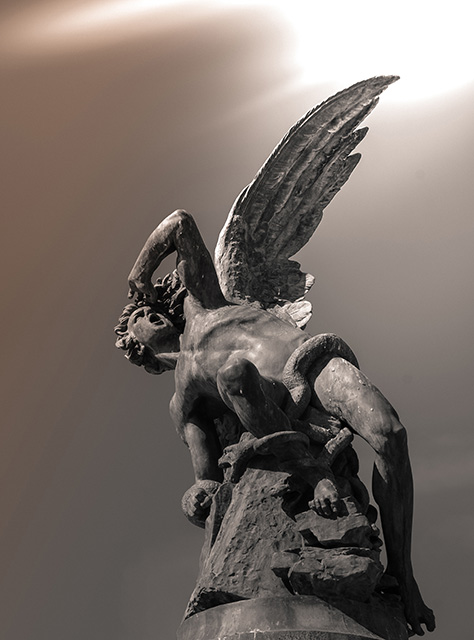 Fine art photo of a statue of the fallen angel in Retiro Park, Spain